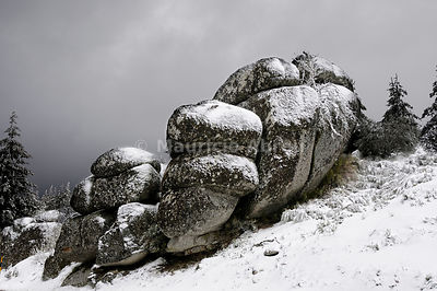 Granitic rocks with snow in Serra da Estrela Natural Park, Beira Alta, Portugal