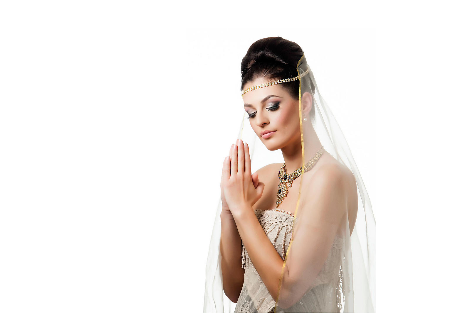 Indian-bride-wearing-white-veil-against-white-background-copyright-Rob-Johns_20130523_RJ_2372