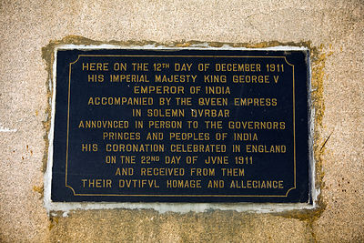India - Delhi - A plaque beneath an obelisk marks the site of the Coronation Durbar near Delhi, India. The site commemorates the Durbar of 1911 when King George V was declared Emperor of India.