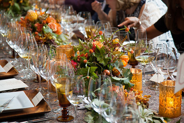 People eating and drinking at a beautifully decorated table at a party
