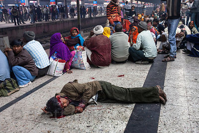 A man lies bleeding on the Sealdah railway station platform in Kolkata, India. He remained there for about an hour before an ambulance arrived. The nature of the injury is unkown.