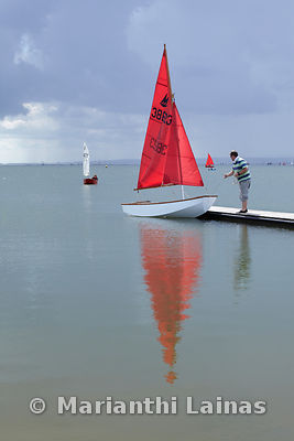 Red sailing boat at the jetty at West Kirby marine lake