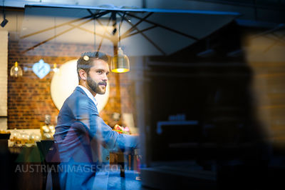Confident businessman in a cafe