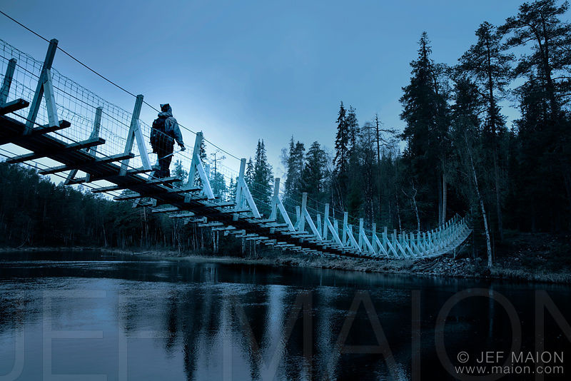 Hiker on suspended bridge