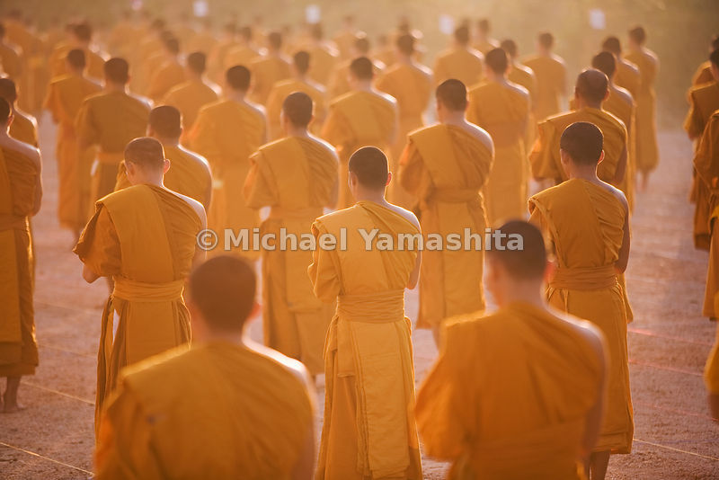 Buddhist monks during morning prayer in Nong Kai, Thailand.