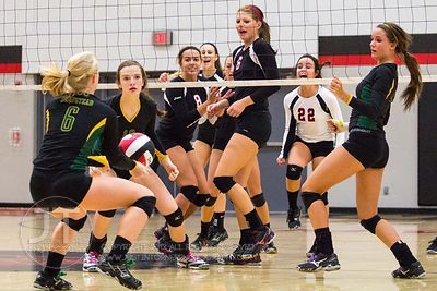 Linn-Mar players react to a missed volley versus Dubuque Hempstead at the 2012 Linn-Mar Varsity Volleyball Tourney Saturday, September 8, 2012. (Justin Torner/Freelance)