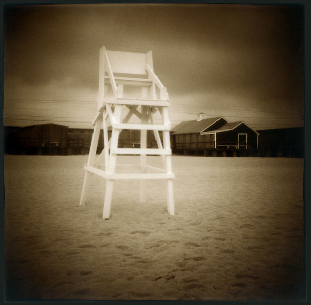 Empty life guard chair in sepia.