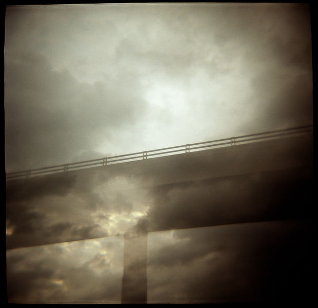 moody cloudy bridge