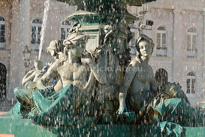 Mythological sculptures in a fountain dating back to 1889. Praça Dom Pedro IV, Rossio. Lisbon, Portugal