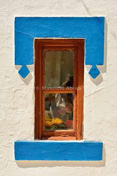 Window of the traditional little village of Santa Susana, very rich in traditional architecture with white washed houses and a strong blue surrounding windows and doors. Alentejo, Portugal