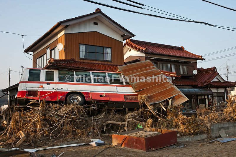 March 11 Great Eastern Japan Earthquake and Tsunami. Measuring 9, biggest ever to hit Japan destroying the NE coast line cities and villages for 200 plus miles. Tori gate is left standing in Motoyoshicho..Bus slammed into side of house.