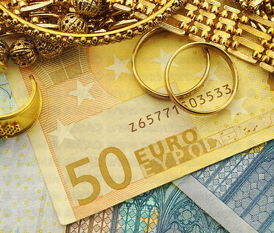 Gold jewelry with euro banknotes