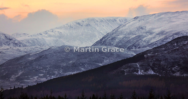 Carn Dearg with adjacent Monadhliath Mountains, dusted with snow in late afternoon on New Year's Day, Strathspey, Scottish Highlands