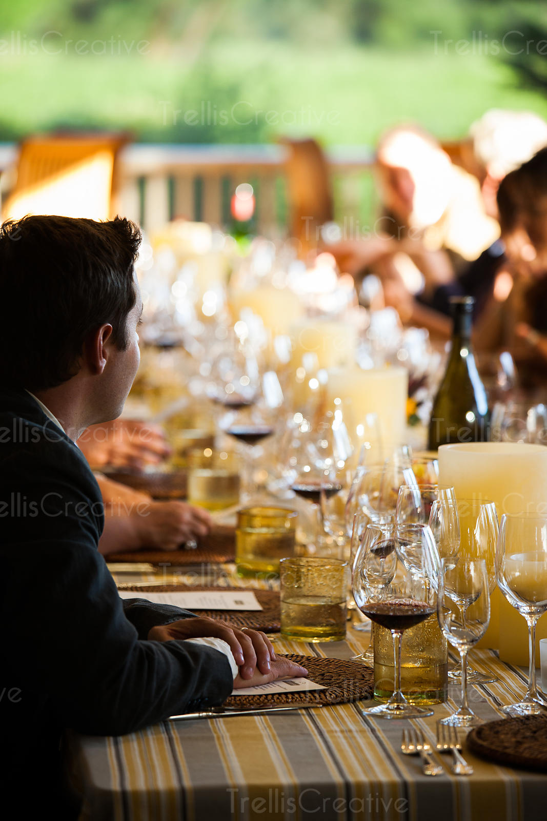 People drinking wine at an outdoor dinner party