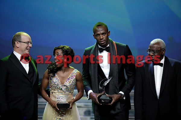 Usain Bolt and Shelly-Ann Fraser-Pryce hold their awards for the Male and Female World Athletes of the Year for 2013