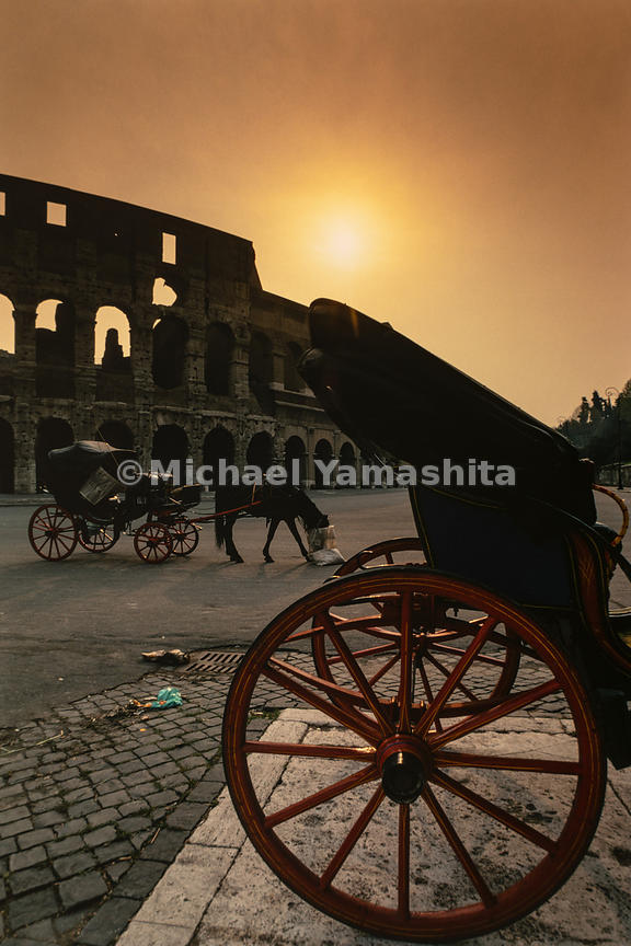 Carriages are pulled by horses directly outside the Colosseum. Rome, Italy, March, 1978.