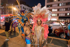 People wearing Brazil carnival style costume for New York Fashion Weekn on the street in NY.