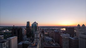 Medium Shot: Sunset Framed Above Downtown Kansas City Skyline