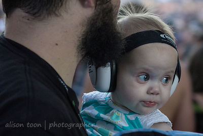 Baby with ear protectors,  Aftershock 2013