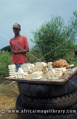 boy selling souvenires made of coral next to the Coral Quarry, Rodrigues