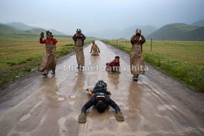 Along the pilgrimage route to Lhasa, faithful Buddhists prostrate themselves fully in an elaborate exercise over hundreds, sometimes thousands of miles.