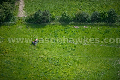 Aerial view of old tractor in grass field