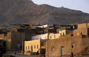 village built on the slopes of the desert mountains between the temples of ancient Thebes, West Bank, Luxor, Egypt