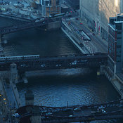 Elevated view looking west of Wacker Drive, Chicago River and bridges with morning light and EL train, Chicago, Illinois, USA
