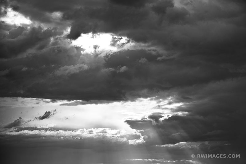 STORMY CLOUDS SUN RAYS GREAT SAND DUNES NATIONAL PARK COLORADO ATMOSPHERIC NATURE ABSTRACT BLACK AND WHITE