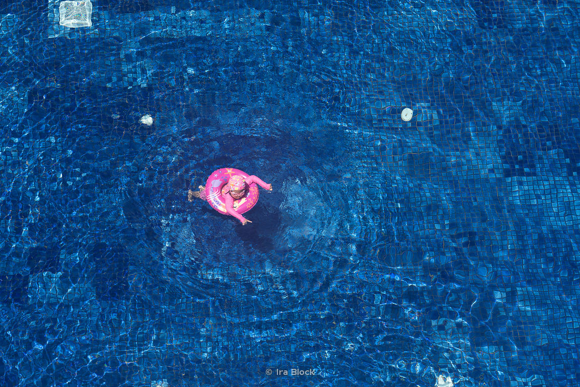 A child swimming in a hotel pool in Sentosa island in Singapore.