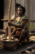 Woman preparing food in front of her stilted house, Nzulezo stilt village on Lake Amansuri, Ghana