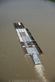 Aerial photograph of a tug and barge pushing upstream on the Mississippi River near Memphis, Tennessee