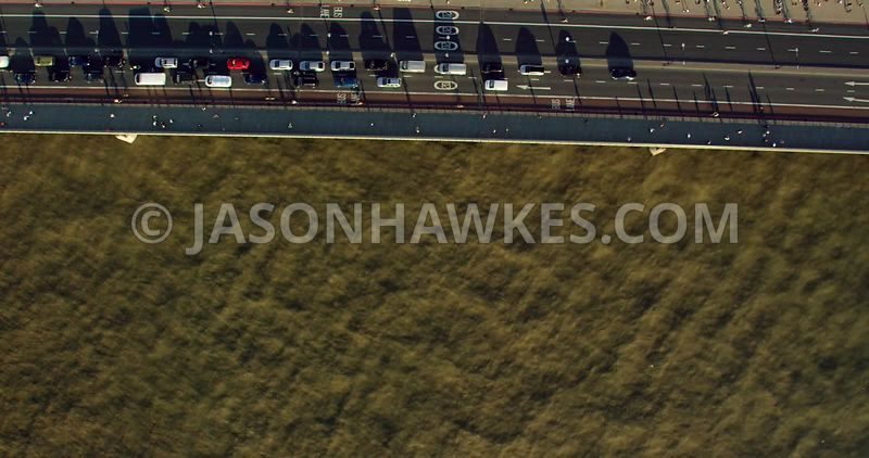 Aerial footage of commuters and traffic crossing London Bridge, River Thames, London.