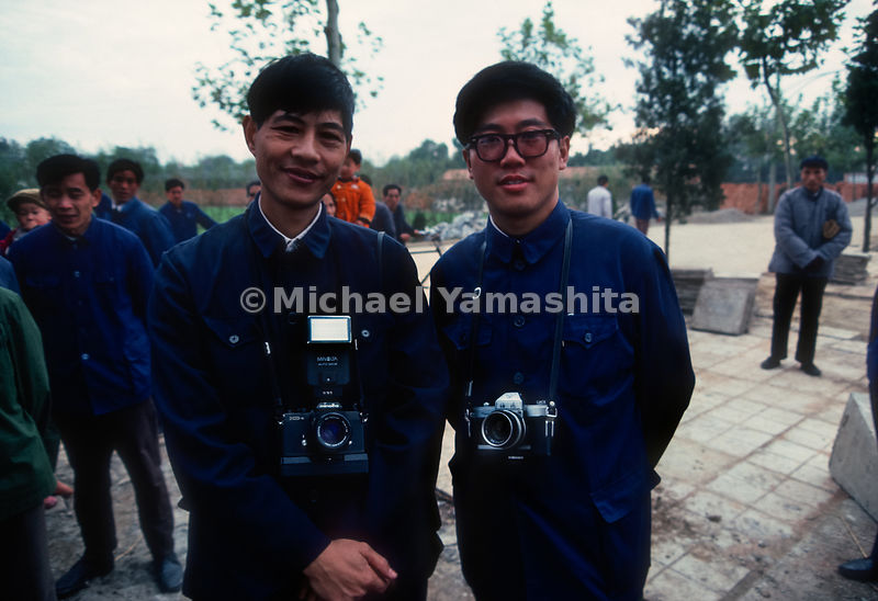 Tourists pose with their cameras in Zhongshan, China.