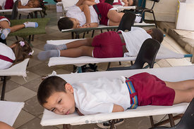 Elementary schoold students taking a nap at school in Trinidad, Cuba.