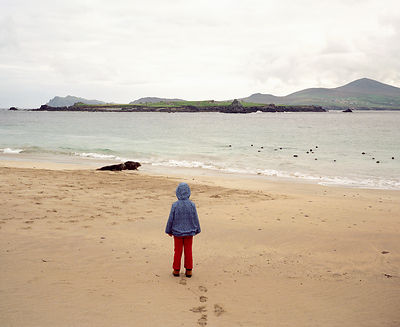Girl standing on empty beach