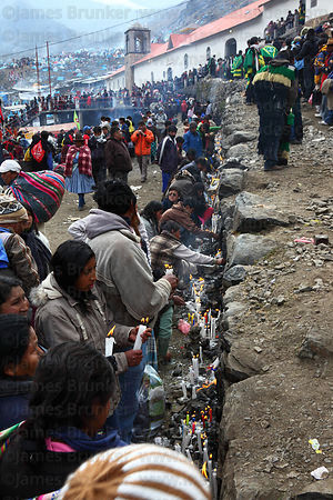 Devotees lighting candles outside Sanctuary during Qoyllur Riti festival, Peru