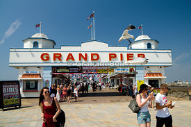 Young couple  being attacked by gulls whilst eating doughtnuts, Grand Pier, Weston-Super-Mare, Somerset, England.