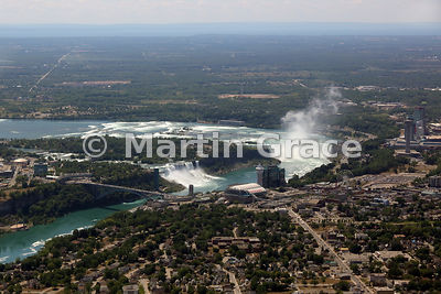 Niagara Falls from the air, looking over the Canadian town to Rainbow Bridge; American and Bridal Veil Falls (USA); Goat Island (USA); Canadian Horseshoe Falls, Ontario, Canada