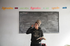 Young single mothers attend a slam course therapy given by the slam-poet Razanadranto Landy Cathia, better known as Caylah, in Antananarivo on July 29, 2016. In Madagascar, where more than a third of women got pregnant before their 20, young mothers often all by themselves find comfort into slam music, that let them put words on their pain and break taboos.
