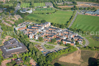 Aerial view of new housing in village near Guildford, Surrey