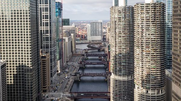 Bird's Eye: A Tight Shot of Dramatic Cloud Shadows Rolling Over High-Rises & The Chicago River