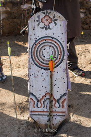 Arrows in a wooden archery target at an archery contest in Paro, Bhutan.