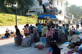 Luang Prabang, Laos - Street traders unloading good from truck.