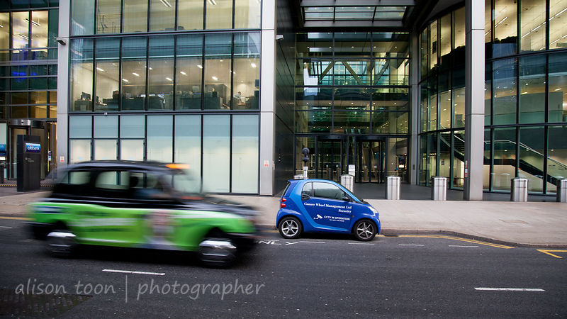 London cabs driving through docklands architecture