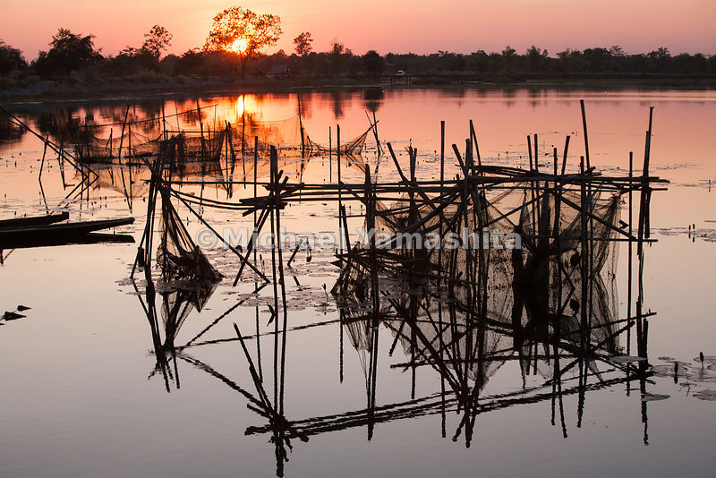 Wetlands at sunset, fish traps.