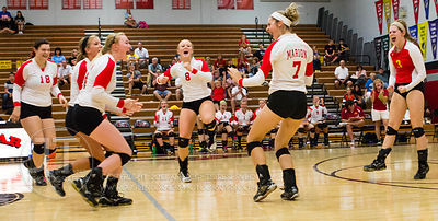 Marion players celebrate a point scored at the 2012 Linn-Mar Varsity Volleyball Tourney Saturday, September 8, 2012. (Justin Torner/Freelance)