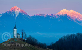 Last lights on the Kamnik-Savinja Alps (Storžič peak on the left) with Church of St. Primož, Jamnik.