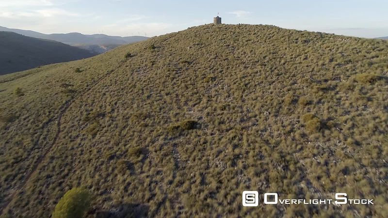 Drone Video Spanish Flag and Watchtower on a Hill Granada Spain