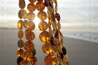 Amber necklaces at sunset moving in the wind